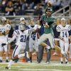 Norman North\'s Jake Higginbotham (12) makes a catch against Edmond North\'s Lindell Tate (21) during a high school football game between Edmond North and Norman North in Norman, Okla., Thursday, Oct. 11, 2012. Photo by Nate Billings, The Oklahoman