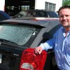 Rob Stanley looks at hail damage at David Stanley Dodge in Midwest City Friday morning Friday, May 2, 2008. (Photo by Robert Medley, THE OKLAHOMAN