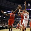Los Angeles Clippers guard Eric Bledsoe (12) blocks a shot by Chicago Bulls guard Marco Belinelli (8) as Clippers\' Matt Barnes also defends during the first half of an NBA basketball game, Tuesday, Dec. 11, 2012, in Chicago. (AP Photo/Charles Rex Arbogast)
