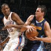 Denver\'s Danilo Gallinari (8) fights Oklahoma City\'s Kevin Durant (35) for a loose ball during the NBA basketball game between the Denver Nuggets and the Oklahoma City Thunder in the first round of the NBA playoffs at the Oklahoma City Arena, Wednesday, April 27, 2011. Photo by Sarah Phipps, The Oklahoman