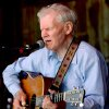 FILE - In this May 1, 2005 file photo, master flatpicker Doc Watson plays during the