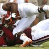OU\'s Corey Nelson (7) brings down UT\'s Johnathan Gray (32) during the Red River Rivalry college football game between the University of Oklahoma (OU) and the University of Texas (UT) at the Cotton Bowl in Dallas, Saturday, Oct. 13, 2012. Photo by Chris Landsberger, The Oklahoman