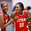 Carl Albert Lady Titans\' Toni Cheadle, right, celebrates with teammate Alicia Frazier after their team\'s 47-35 win over the Millwood Lady Falcons in the 2012 Titan Classic Basketball Tournament at Carl Albert High School, Saturday, Jan. 21, 2012. Carl Albert won the tournament champions in the girls bracket. Cheadle was named as a player on the all-tournament team after the win. Photo by Jim Beckel, The Oklahoman