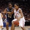 Ashley Paris dribbles past Xenia Stewart in the second half of the NCAA women\'s basketball tournament game between the University of Oklahoma and Pittsburgh at the Ford Center in Oklahoma City, Okla. on Sunday, March 29, 2009. PHOTO BY STEVE SISNEY, THE OKLAHOMAN