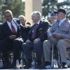 Photo - U.S. President Barack Obama, second left, and French President Francois Hollande sit on stage with veterans, at Normandy American Cemetery at Omaha Beach as he participates in the 70th anniversary of D-Day in Colleville sur Mer, in Normandy, France, Friday, June 6, 2014. (AP Photo/Charles Dharapak)