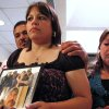 Rosemary Silva holds a photo of homicide victim Ruben Silva, 47, Tuesday, July 21, 2009, at the Oklahoma City police department during a press conference. Ruben Silva was killed June 21, 2009 at 738 N Indiana in Oklahoma City. Behind Rosemary is her husband Rodolfo Silva, the victim\'s brother, and Rosa Silva, his sister, right. Photo by Robert Medley, The Oklahoman