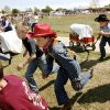 About 100 fourth-graders at Gilmour Elementary School in Kingfisher re-enacted the April 22, 1889 Land Run that opened the Unassigned Lands in Indian Territory to settlement by the U.S. Government. Boys, girls and teachers dressed in period clothes and pulled covered wagons across the playground. The school cafeteria provided pail lunches, featuring fried chicken, biscuits and an apple. Photo by JIM BECKEL, THE OKLAHOMAN