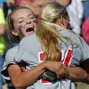 Hilldale\'s Sarah Hughey hugs Destiny Riddle, right, as they defeat Bethel 7-0 in the State 4A Softball Championship game on Saturday, Oct. 19, 2013 in Shawnee, Okla. Photo by Steve Sisney, The Oklahoman
