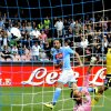 Photo - Napoli's Gonzalo Higuain beats Lazio goalkeeper Etrit Berischa to score a goal during a Serie A soccer match between Napoli and Lazio, at the San Paolo stadium in Naples, Italy, Sunday, April, 13, 2014. (AP Photo/Salvatore Laporta)