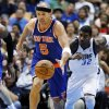 New York Knicks\' Jason Kidd (5) comes away with a steal against Dallas Mavericks\' Chris Kaman, not pictured, as O.J. Mayo (32) gives chase in the first half of an NBA basketball game, Wednesday, Nov. 21, 2012, in Dallas. (AP Photo/Tony Gutierrez)
