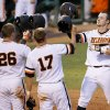 Photo - Oklahoma State's Conor Costello celebrates after hitting a four-run home run in the fifth inning of a college baseball game against Oklahoma in Oklahoma City, Thursday, May 15, 2014. (AP Photo/The Oklahoman, Bryan Terry)