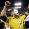 Oakland Athletics\' Stephen Vogt celebrates after getting a shaving cream pie to the face from teammate Josh Reddick after Vogt made the game-winning hit to beat the Detroit Tigers 1-0 in Game 2 of the American League baseball Division Series in Oakland, Calif., Saturday, Oct. 5, 2013. (AP Photo/Marcio Jose Sanchez)