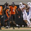Texas\' Jaxon Shipley (8) and D.J. Grant (18) celebrate beside Oklahoma State\'s Shamiel Gary (7) and Justin Gilbert (4) after touchdown during a college football game between Oklahoma State University (OSU) and the University of Texas (UT) at Boone Pickens Stadium in Stillwater, Okla., Saturday, Sept. 29, 2012. Oklahoma State lost 41-36. Photo by Bryan Terry, The Oklahoman