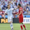 Photo - Iran's Reza Ghoochannejhad talks to Argentina's Lucas Biglia following Argentina's 1-0 victory over Iran during the group F World Cup soccer match between Argentina and Iran at the Mineirao Stadium in Belo Horizonte, Brazil, Saturday, June 21, 2014. (AP Photo/Martin Meissner)