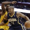 Photo - Indiana Pacers' David West, right, drives past Cleveland Cavaliers' Tristan Thompson, from Canada, during the second quarter of an NBA basketball game Sunday, March 30, 2014, in Cleveland. (AP Photo/Tony Dejak)