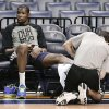 Photo - Oklahoma City Thunder forward Kevin Durant gets his ankle treated during practice Friday, April 25, 2014, in Memphis, Tenn. The Thunder face the Memphis Grizzlies on Saturday in Game 4 of their opening-round NBA basketball playoff series. The Grizzlies lead the series 2-1. (AP Photo/Mark Humphrey)