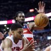 Toronto Raptors forward Rudy Gay chases down a loose ball against Washington Wizards center Nene, rear, during the first half of their NBA basketball game, Monday, Feb. 25, 2013, in Toronto. (AP Photo/The Canadian Press, Frank Gunn)