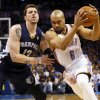 Oklahoma City\'s Derek Fisher (6) drives against Memphis\' Mike Miller (13) during an NBA basketball game between the Memphis Grizzlies and the Oklahoma City Thunder at Chesapeake Energy Arena in Oklahoma City, Friday, Feb. 28, 2014. Photo by Nate Billings, The Oklahoman