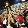 The Alabama Crimson Tide celebrates with the champioship trophy after winning Game 3 of the Women\'s College World Series softball championship between OU and Alabama at ASA Hall of Fame Stadium in Oklahoma City, Wednesday, June 6, 2012. Alabama won the third game, 5-4. Photo by Nate Billings, The Oklahoman