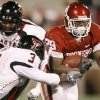 OU\'s Chris Brown fights off Jamar Wall of Texas Tech during the college football game between the University of Oklahoma Sooners and Texas Tech University at Gaylord Family -- Oklahoma Memorial Stadium in Norman, Okla., Saturday, Nov. 22, 2008. BY BRYAN TERRY, THE OKLAHOMAN