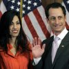 Photo - FILE - In this Jan. 5, 2011, file photo, Anthony Weiner and his wife Huma Abedin pose for photographs after the ceremonial swearing in of the 112th Congress on Capitol Hill in Washington. Abedin, who was notably absent five months later when Weiner resigned his congressional seat and admitted sending lewd Twitter photos to women, has been a key player in his surging mayoral run. She's appeared in his campaign launch video, raised tens of thousands of dollars and joined him on the campaign trail. (AP Photo/Charles Dharapak, File)