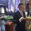 Photo - FILE- In this Saturday, June 7, 2014 file photo Ukrainian President Petro Poroshenko lights a candle in St. Sophia Cathedral after his inauguration in Kiev, Ukraine. Ukrainian President Petro Poroshenko said Wednesday, June 18, 2014, that government forces will unilaterally cease fire to allow pro-Russian separatists in the east of the country a chance to lay down weapons or leave the country, a move that follows his conversations with Russian and German leaders. (AP Photo/Mykola Lazarenko, Pool, file)