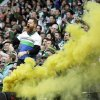 Photo - A Portland Timbers fan celebrates a goal during the second half of an MLS soccer game against the Seattle Sounders in Portland, Ore., Saturday, April 5, 2014.  The teams tied 4-4.  (AP Photo/Don Ryan)