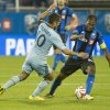 Photo - Sporting Kansas City's Benny Feilhaber rushes in to steal the ball from Montreal Impact's Patrice Bernier during the second half of a soccer game, Saturday, July 12, 2014 in Montreal. (AP Photo/The Canadian Press, Peter McCabe)