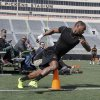 OSU\'s Joseph Randle rounds a cone as part of an agility test during Pro Day at Boone Pickens Stadium on the campus of Oklahoma State University in Stillwater, OK, Tuesday, March 12, 2013, By Paul Hellstern, The Oklahoman