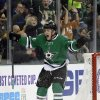 Photo - Dallas Stars center Colton Sceviour celebrates his goal against the Vancouver Canucks during the first period of an NHL hockey game, Thursday, Dec. 19, 2013, in Dallas. (AP Photo/Tony Gutierrez)