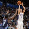 Oklahoma City\'s Andy Rautins (8) shoots over Charlotte\'s Ben Gordon (8) during the preseason NBA game between the Oklahoma City Thunder and the Charlotte Bobcats at Chesapeake Energy Arena in Oklahoma City, Tuesday, Oct. 16, 2012. Photo by Sarah Phipps, The Oklahoman