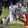 Kansas State quarterback Collin Klein (7) scores a touchdown against TCU during the third quarter of an NCAA college football game, Saturday, Nov. 10, 2012, in Fort Worth, Texas. (AP Photo/LM Otero)