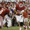 Oklahoma\'s Landry Jones (12) hands off to Dominique Whaley (8) during the second half of the college football game between the University of Oklahoma Sooners ( OU) and the Tulsa University Hurricanes (TU) at the Gaylord Family-Memorial Stadium on Saturday, Sept. 3, 2011, in Norman, Okla. Photo by Steve Sisney, The Oklahoman ORG XMIT: KOD