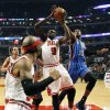 Chicago Bulls forward Luol Deng (9) shoots under pressure from Oklahoma City Thunder forward Kevin Durant (35) as Bulls\' Richard Hamilton, foreground, watches during the first half of an NBA basketball game, Thursday, Nov. 8, 2012, in Chicago. (AP Photo/Charlie Arbogast) ORG XMIT: CXA104