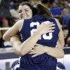 Shawnee\'s Taylor Cooper (10) and McKenzie Cooper (20) hug after the Class 5A girls high school basketball state tournament championship game between Shawnee and East Central at the Mabee Center in Tulsa, Okla., Saturday, March 10, 2012. Shawnee won, 45-41. Photo by Nate Billings, The Oklahoman