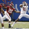 Oklahoma\'s Lacoltan Bester (11) makes a touchdown catch in front of Alabama\'s Landon Collins (26) and Trey DePriest (33) during the NCAA football BCS Sugar Bowl game between the University of Oklahoma Sooners (OU) and the University of Alabama Crimson Tide (UA) at the Superdome in New Orleans, La., Thursday, Jan. 2, 2014. .Photo by Chris Landsberger, The Oklahoman