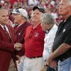 Athletic Director Joe Castiglione shakes hands with members of the 1956 Sooner football team introduced during the first half of the college football game between the University of Oklahoma Sooners (OU) and the Ball State Cardinals at Gaylord Family-Oklahoma Memorial Stadium on Saturday, Oct. 1, 2011, in Norman, Okla. Photo by Steve Sisney, The Oklahoman