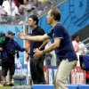 United States\' head coach Juergen Klinsmann, right, questions a call as Germany\'s head coach Joachim Loew looks on during the group G World Cup soccer match between the United States and Germany at the Arena Pernambuco in Recife, Brazil, Thursday, June 26, 2014. (AP Photo/Julio Cortez)