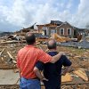 Jerry Vonderhaar, left, comforts Charles Kellogg after severe weather hit the Eagle Point subdivision in Limestone County, Ala. on Friday, March 2, 2012. A reported tornado destroyed several houses in northern Alabama as storms threatened more twisters across the region Friday (AP Photo/The Decatur Daily, Jeronimo Nisa) ORG XMIT: ALDEC109