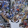 Mikhail Youzhny, of Russia, reacts after defeating Lleyton Hewitt, of Australia, during the fourth round of the 2013 U.S. Open tennis tournament, Tuesday, Sept. 3, 2013, in New York. (AP Photo/Kathy Willens)
