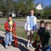 Trike-A-Thon particpants Jack Wagner, Zane Howl and Cooper Jones are helped by fifth grader Elizabeth Renouard. Community Photo By: Suzanne Airington Submitted By: Suzanne,