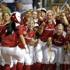 Oklahoma\'s Lauren Chamberlain is greeted at home after hitting a home run in the third inning against Washington during Women\'s College World Series softball game at ASA Hall of Fame Stadium in Oklahoma City, Sunday, June, 2, 2013. Photo by Sarah Phipps, The Oklahoman Download