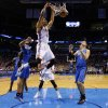 Oklahoma City\'s Thabo Sefolosha (25) dunks in front of Orlando\'s Nikola Vucevic (9) during the NBA basketball game between the Oklahoma City Thunder and the Orlando Magic at the Chesapeake Energy Arena, Sunday, Dec. 15, 2013. Photo by Sarah Phipps, The Oklahoman