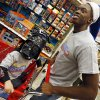 Reggie Jackson of the Oklahoma City Thunder pushes Levi Dean, 3, in a shopping cart as Dean wears a Darth Vader mask during the Oklahoma City Thunder\'s annual Holiday Assist shopping spree at Target, 13924 N Pennsylvania, in Oklahoma City, Monday, Dec. 10, 2012. The ten families who participated in this year\'s shopping spree are from Sunbeam Family Services\' Grandparents Raising Grandchildren program. Photo by Nate Billings, The Oklahoman