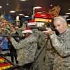 New recruit Pvt Daniel Hearn sports reindeer antlers while playing a shooting games during a lunch stop at Gatti Town during Soldiers Day Out, Friday, December 21, 2012. Edmond/North OKC Blue Star Mothers will be taking the soldiers who can\'t go home for Christmas around the metro for a day of fun. Photo By David McDaniel/The Oklahoman