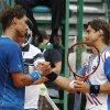 Photo - Rafael Nadal of Spain, left, and David Ferrer of Spain, right, shake hands after their quarterfinals match of the Monte Carlo Tennis Masters tournament in Monaco, Friday, April 18, 2014. Ferrer won 7-6 6-4. (AP Photo/Michel Euler)