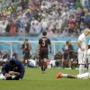 United States\' Alejandro Bedoya, left, and United States\' Jermaine Jones are tended to by medical personnel after colliding during the group G World Cup soccer match between the USA and Germany at the Arena Pernambuco in Recife, Brazil, Thursday, June 26, 2014. (AP Photo/Ricardo Mazalan)