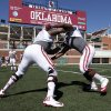Charles Walker, left and Mike Onuoha go through drills as the University of Oklahoma Sooners (OU) begin spring practice on fields next to Gaylord Family-Oklahoma Memorial Stadium in Norman, Okla., on Tuesday, March 11, 2014. Photo by Steve Sisney, The Oklahoman