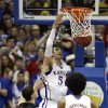 Kansas\' Jeff Withey (5) dunks the ball past Texas\' Ioannis Papapetrou (33) during the second half of an NCAA college basketball game Saturday, Feb. 16, 2013, in Lawrence, Kan. Kansas won 73-47. (AP Photo/Ed Zurga)