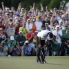 Photo - Bubba Watson reacts after winning the Masters golf tournament Sunday, April 13, 2014, in Augusta, Ga. (AP Photo/Darron Cummings)